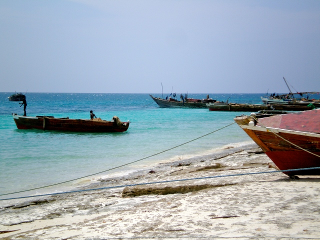Fisherman and boats in the Indian Ocean.