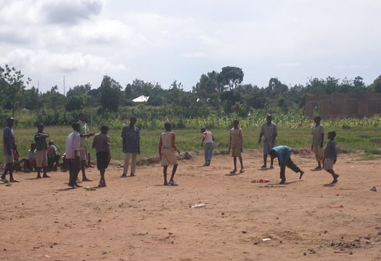 Boys play a game in the yard next to the dormitories.